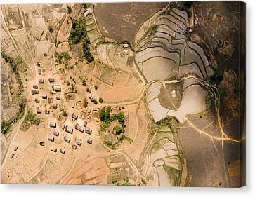 A Small Rice Village In The Central Canvas Print by Michael Fay