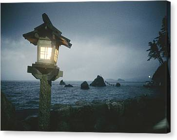 A Small Wooden Lantern Looks Canvas Print by Luis Marden