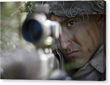 A Sniper Sights In On A Target Canvas Print by Stocktrek Images