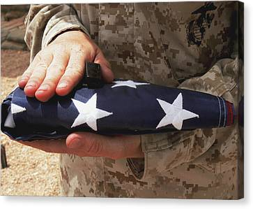A Soldier Holds The United States Flag Canvas Print by Stocktrek Images