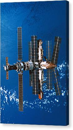 A Space Station Orbiting In Space Canvas Print by Stockbyte