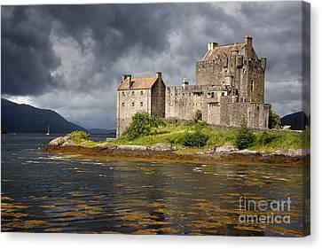 A Storm Brews Over Eilean Donan Castle Canvas Print by Jane Rix