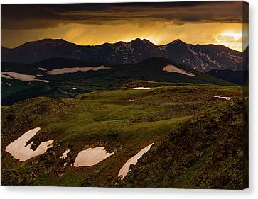 Canvas Print featuring the photograph A Stormy Alpine Sunset by John De Bord