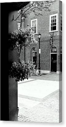 Canvas Print featuring the photograph A Stroll Through Town Square by Laura DAddona