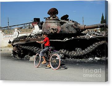 A Syrian Boy On His Bicycle In Front Canvas Print by Andrew Chittock