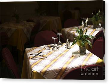 A Table Is Waiting In Sorrento Canvas Print by John Rizzuto