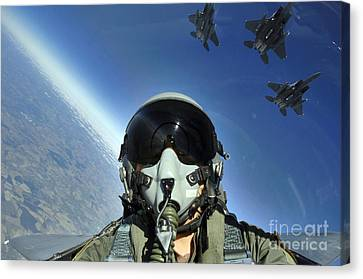 A Three-ship Formation Of F-15e Strike Canvas Print by Stocktrek Images
