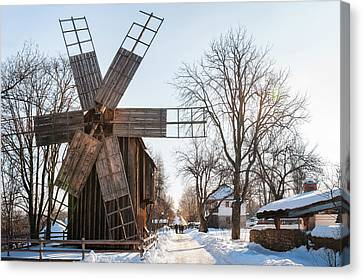 A Traditional Windmill On A Snow-covered Street At The Village Museum, Bucharest Canvas Print