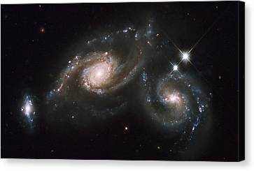 A Triplet Of Galaxies Known As Arp 274 Canvas Print by Stocktrek Images