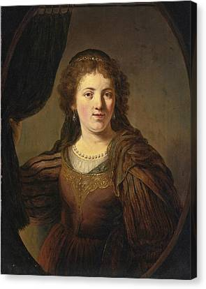 A Tronie Of A Young Woman In An Eastern Costume Drawing A Curtain To One Side In A Painted Oval Canvas Print by Govert Flinck