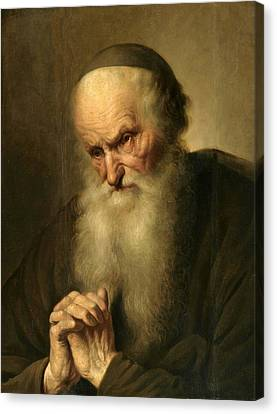 A Tronie Of An An Old Man At Prayer Canvas Print by Jacques des Rousseaux