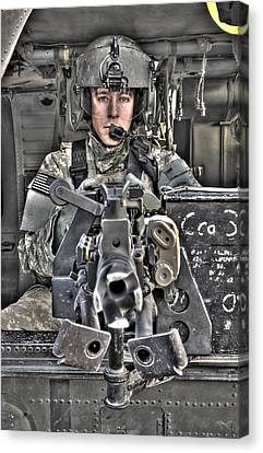 Operation Iraqi Freedom Canvas Print - A Uh-60 Black Hawk Door Gunner Manning by Terry Moore