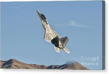 A U.s. Air Force F-22 Raptor Takes Canvas Print by Giovanni Colla
