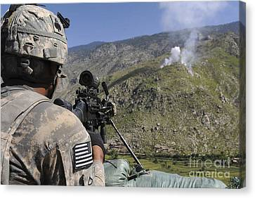 A U.s. Army Grenadier Scans A Nearby Canvas Print by Stocktrek Images