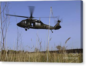 Iraq Canvas Print - A U.s. Army Uh-60 Black Hawk Helicopter by Stocktrek Images