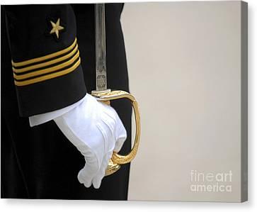 A U.s. Naval Academy Midshipman Stands Canvas Print by Stocktrek Images