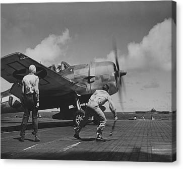 A Us Navy Fighter Pilot Gets The Take Off Flag From The Deck Crew Of An Aircraft Carrier Canvas Print by American School