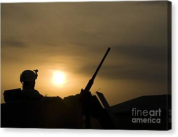 A Us Soldier Mans His .50 Caliber While Canvas Print by Terry Moore