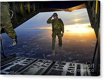 On The Move Canvas Print - A U.s. Soldier Salutes His Fellow by Stocktrek Images