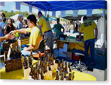 Saugerties Canvas Print - A Vendor At The Garlic Fest Offers Garlic Vinegar And Olive Oil For Sale by Lanjee Chee