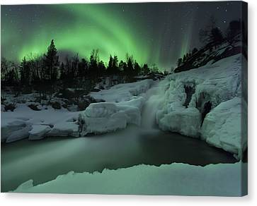 A Wintery Waterfall And Aurora Borealis Canvas Print by Arild Heitmann