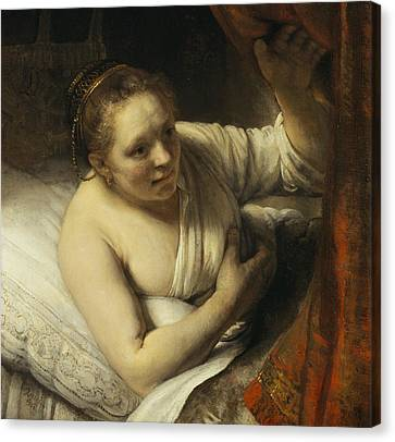 A Woman In Bed Canvas Print by Rembrandt