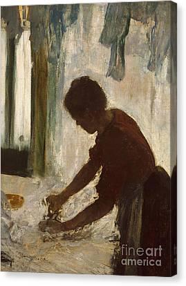A Woman Ironing, 1873 Canvas Print by Edgar Degas
