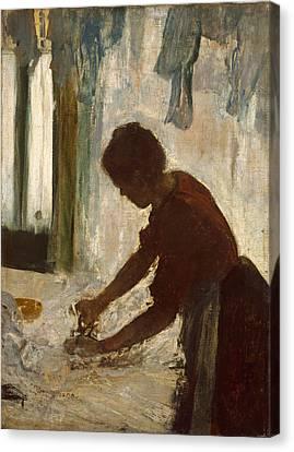 A Woman Ironing Canvas Print by Edgar Degas
