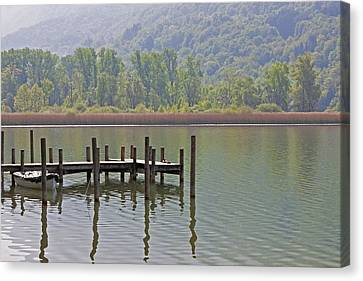 A Wooden Pier At A Small Lake Canvas Print by Joana Kruse