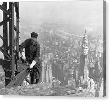 A Worker Bolts Beams During Construction Canvas Print by Lewis Wickes Hine