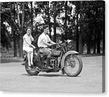 A Young Man Drives A  Motorcycle While Canvas Print by Everett