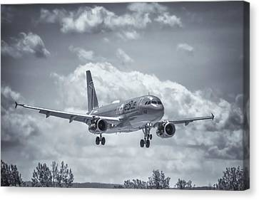 A320 On Approach Canvas Print by Guy Whiteley