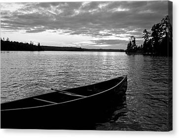 Abandoned Canoe Floating On Water Canvas Print by Keith Levit