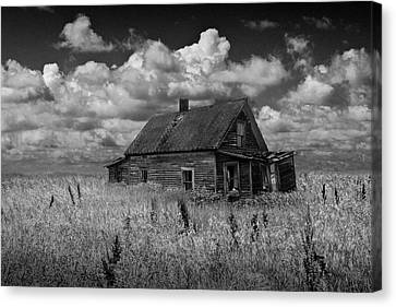 Abandoned Prairie Farm House In Black And White Canvas Print by Randall Nyhof