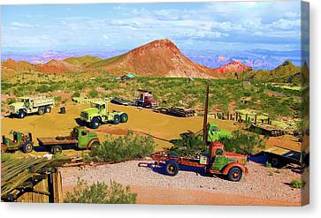 Abandoned Trucks In A Desert Canvas Print