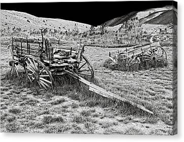 Abandoned Wagons Of Bannack Montana Ghost Town Canvas Print by Daniel Hagerman