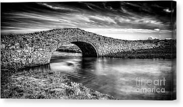 Aberffraw Bridge V2 Canvas Print by Adrian Evans