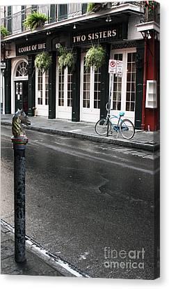 Across The Street Canvas Print by John Rizzuto