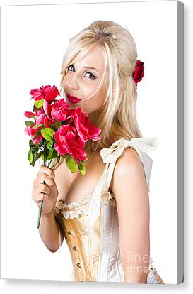 Youthful Canvas Print - Adorable Florist Woman Smelling Red Flowers by Jorgo Photography - Wall Art Gallery