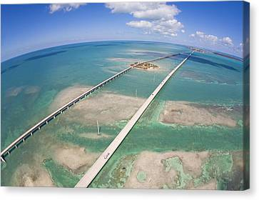 Aerial Of Seven Mile Bridge At Extreme Canvas Print by Mike Theiss