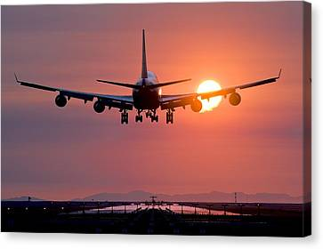 Aeroplane Landing At Sunset, Canada Canvas Print by David Nunuk