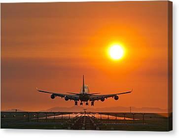 Aeroplane Landing At Sunset Canvas Print