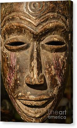 African Tribal Mask. Canvas Print by John Greim