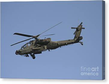 Ah-64 Apache In Flight Over The Baghdad Canvas Print by Terry Moore