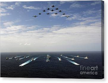 Aircraft Fly Over A Group Of U.s Canvas Print by Stocktrek Images