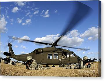 Airmen Provide Security In Front Canvas Print by Stocktrek Images