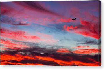 Canvas Print featuring the photograph Airplane In The Sunset by April Reppucci