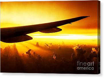 Airplane On Sunset Canvas Print