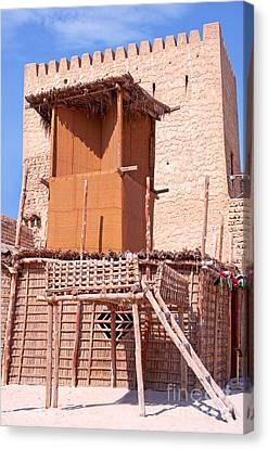 Al Manama Summer Bed And House With Cooling Tower Canvas Print by Chris Smith