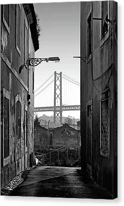 Alley And Bridge Over Tagus, Lisbon Canvas Print by Carlos Caetano